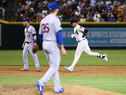 June 14, 2018 - Phoenix, AZ, U.S. - PHOENIX, AZ - JUNE 14: Arizona Diamondbacks third baseman Jake Lamb (22) runs the bases after hitting a homerunduring the MLB baseball game between the Arizona Diamondbacks and the New York Mets on June 14, 2018 at Chase Field in Phoenix, AZ (Photo by Adam Bow/Icon Sportswire) (Credit Image: © Adam Bow/Icon SMI via ZUMA Press)