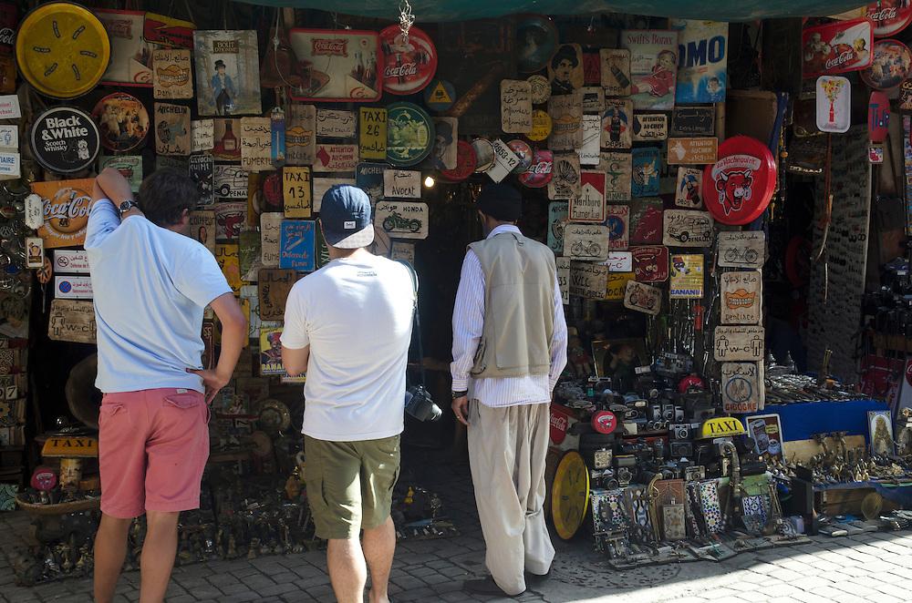 Tourists outside a souvenir shop in Marrakech Morocco