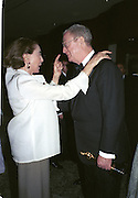 Michael Caine and Mica Ertegun. Miramax post Oscar party. Beverley Hills Hotel. 26 March 2000. © Copyright Photograph by Dafydd Jones 66 Stockwell Park Rd. London SW9 0DA Tel 020 7733 0108 www.dafjones.com