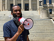 """June 1, 2020 Jackson, MS Demonstrator and activist Adolfo Minka, attorney, speaks his mind and talks with other demonstrators our side the Mississippi State Capitol. <br /> Today at the Mississippi State Capitol 29 yr old history teacher from Cardozo Middle School ,Dhahran Hall, spoke truth to power and lead  demonstrators in support of Black Lives Matter and the murder of George Floyd and police brutality and systematic racism. Protestors gathered at the State Capitol and marched around downtown Jackson returning to the Capitol they chanted """" Say There Names"""", """" I can't Breathe"""", """" No Justice No Peace"""" """" Justice for George Floyd"""" it was a very peaceful protest and march.  In the past 6 days protests and riots have broken out across America in response to the brutal killing of an unarmed African American man by the knee and hands of Minnesota Police<br /> Officers. Photo copyright © @suzialtman #Suzi Altman #protest#peace #blacklivesmatter #georgefloyd #policebrutality #racism #america #mississippi #peacefulprotest #teachlovenothate, white supremacy, cover-19, corona virus, pandemic"""