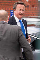 © Licensed to London News Pictures . 07/08/2013 . Manchester , UK . The British Prime Minister DAVID CAMERON arrives at the Jamia Masjid Mosque in Cheetham Hill , Manchester this afternoon (7th August 2013) . Photo credit : Joel Goodman/LNP