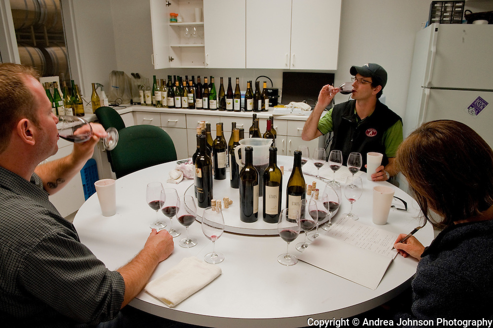 Winemakers sample red wine, Ste Michelle Winery and headquarters, Woodinville, Washington