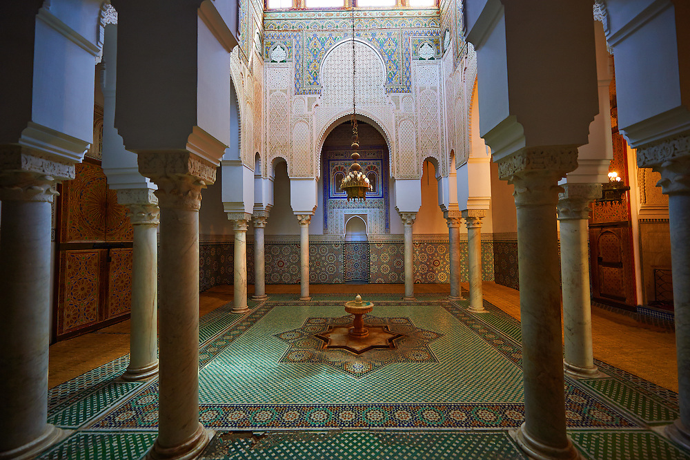 Inner fountain courtyard with Berber Mocarabe Honeycomb work plaster decorations and Berber design tiles of the Mauseleum of Moulay Ismaïl Ibn Sharif , reigned 1672–1727. A UNESCO World Heritage Site .Meknes, Meknes-Tafilalet, Morocco. .<br /> <br /> Visit our MOROCCO HISTORIC PLAXES PHOTO COLLECTIONS for more   photos  to download or buy as prints https://funkystock.photoshelter.com/gallery-collection/Morocco-Pictures-Photos-and-Images/C0000ds6t1_cvhPo<br /> .<br /> <br /> Visit our ISLAMIC HISTORICAL PLACES PHOTO COLLECTIONS for more photos to download or buy as wall art prints https://funkystock.photoshelter.com/gallery-collection/Islam-Islamic-Historic-Places-Architecture-Pictures-Images-of/C0000n7SGOHt9XWI
