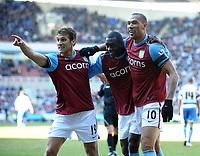 Fotball<br /> England<br /> Foto: Fotosport/Digitalsport<br /> NORWAY ONLY<br /> <br /> Reading v  Aston Villa FA Cup  6th Round 07/03/2010<br /> <br /> John Carew (Aston Villa) celebrates third Villa goal with Stylian Petrov and Emile Heskey