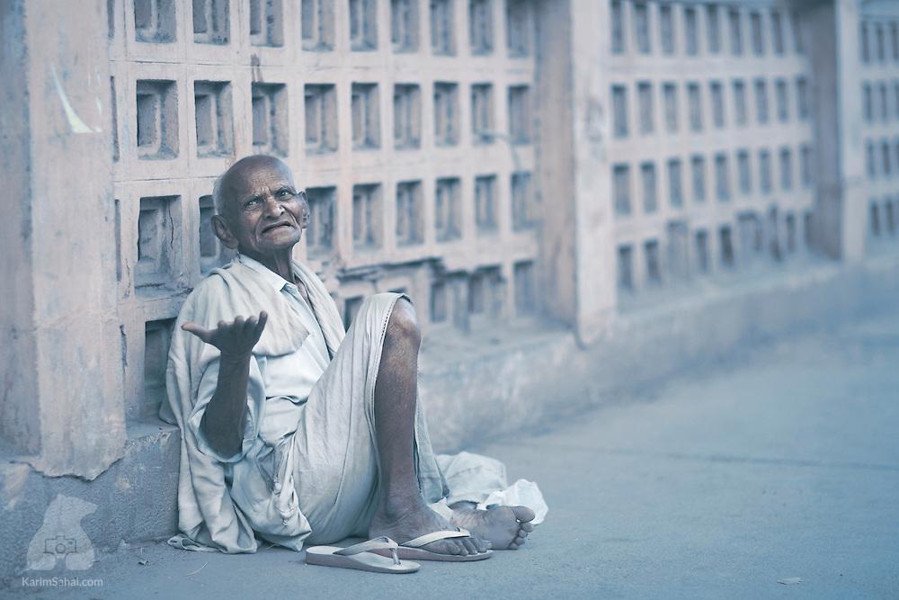 An elderly man begs for money outside the Shri Minakshi temple.