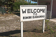 Sign advertising local restaurants along the King's Highway in Alice Town on the tiny Caribbean island of Bimini, Bahamas.