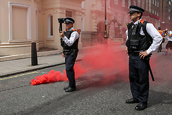 © Licensed to London News Pictures. 03/08/2019. London, UK. A flare is thrown at the police by anti Tommy Robinson protesters during a protest in central London. Last month Tommy Robinson was given a nine-month prison sentence at Old Bailey after he was found guilty of contempt of court.. Photo credit: Dinendra Haria/LNP