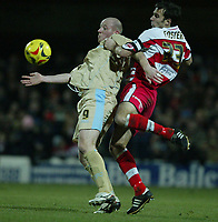 Photo: Aidan Ellis.<br /> Doncaster Rovers v Bristol City. Coca Cola League 1.<br /> 26/11/2005.<br /> Bristol's Steve Brooker holds off Doncaster's Stephen Foster