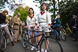 © Licensed to London News Pictures. 04/05/2019. London, UK. Two women wearing vintage tennis outfits at the start of the annual Tweed Run bicycle ride, in which participants cycle around the capital wearing vintage tweed outfits. Photo credit: Rob Pinney/LNP