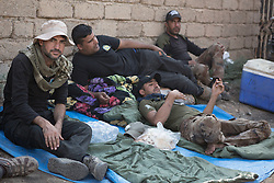 Licensed to London News Pictures. 23/10/2016. Iraqi Army  Counter Terrorism soldiers take relax in the Iraqi Town of Bartella.<br /> <br /> Bartella, a mainly Christian town with a population of around 30,000 people before being taken by the Islamic State in August 2014, was captured two days ago by the Iraqi Army's Counter Terrorism force as part of the ongoing offensive to retake Mosul. Although ISIS militants were pushed back a large amount of improvised explosive devices are still being found in the town's buildings. Photo credit: Matt Cetti-Roberts/LNP