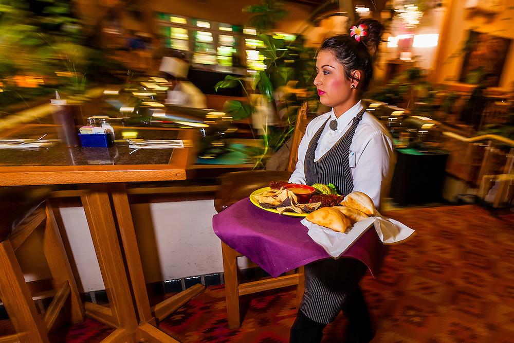 "A waitress carrying a ""fiesta platter"", El Pinto Restaurant and Cantina, Albuquerque, New Mexico USA"