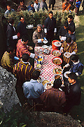 During a celebration of the first electricity to come to this region of Bhutan, visiting dignitaries join village member Namgay (at the head of the table) at a buffet of red rice, potatoes, tomatoes, cucumbers, beef, chicken, and a spicy cheese and chili pepper soup. The villagers have been stockpiling food for the event. Hungry Planet: What the World Eats (p. 42). The Namgay family living in the remote mountain village of Shingkhey, Bhutan, is one of the thirty families featured, with a weeks' worth of food, in the book Hungry Planet: What the World Eats.