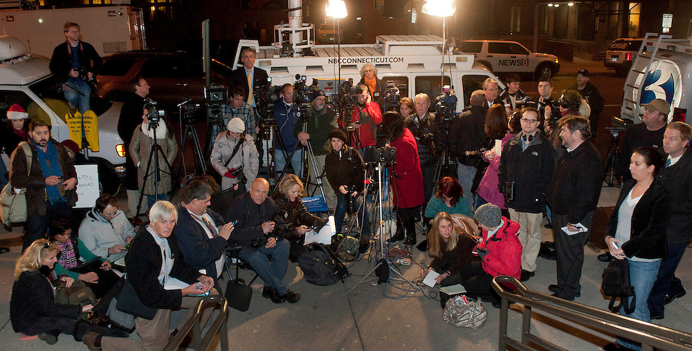 Members of the media wait outside New Haven Conn Superior Court House after the jury condemned Joshua Komisarjevsky to death for the triple murders of Dr. Petit wife and their two daughters at their home in Cheshire Conn. in 2007. .(Photo/Douglas Healey for The New York Times).