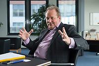 26 FEB 2016, BERLIN/GERMANY:<br /> Frank Bsirske, Vorsitzender der Vereinten Dienstleistungsgewerkschaft, ver.di, während einem Interview, in seinem Buero, ver.di Bundesverwaltung<br /> IMAGE: 20160226-01-003<br /> KEYWORDS: Büro
