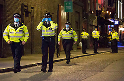 Licensed to London News Pictures. 24/09/2020. London, UK. People make their way home from Soho in central London around 10pm on the first day of the 10PM curfew comes into force. Prime Minister Boris Johnson has announced new measures to attempt to reduce the rising number of new Covid-19 infections. Photo credit: Marcin Nowak/LNP