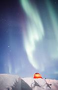 Alaska. Tent camping under the Aurora Borealis in the Alaska Range.