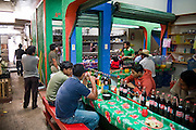 Young men sit down at a market eatery to eat a quick lunch in San Cristobal de las Casas, Chiapas state, Mexico.