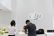 Employees walk through the lobby of DJI, Chinas leading drone maker, at the companys head quarters in Shenzhen, Guangdong province, China, on Tuesday, April 19, 2016. Once synonymous with Chinas manufacturing might, as the days of cheap land and labor recede, the provinces businesses are in a race to upgrade or move.