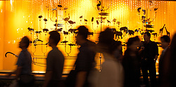 Shoppers walk past illuminated shop window of famous Wako Department store in Ginza Tokyo