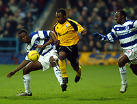 Photo. Chris Ratcliffe<br /> QPR v Rushden & Diamonds. Nationwide Division 2. 03/01/2004<br /> Rodney Jack tries to go past Daniel Shittu and Terrell Forbes of QPR.