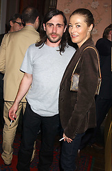 Actress AMANDA DONOHOE and RUSSELL      at a party to celebrate the publication of Strangeland by artist Tracey Emin at 33 Portland Place, London W1 ON 21ST OCTOBER 2005.<br /><br />NON EXCLUSIVE - WORLD RIGHTS