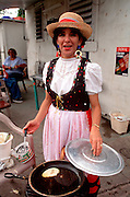 PUERTO RICO, FESTIVALS Three KIngs Festival on Jan 6th in town of Juana Diaz near Ponce; preparing traditional bacalo (codfish) cakes