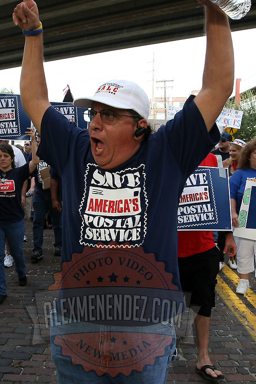 A protester screams in the parade during the Republican National Convention in Tampa, Fla. on Wednesday, August 29, 2012. (AP Photo/Alex Menendez)