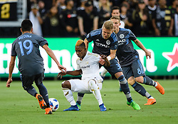 May 13, 2018 - Los Angeles, CA, U.S. - LOS ANGELES, CA - MAY 13: New York City defender Anton Tinnerholm (3) grabs ahold of Los Angeles FC forward Latif Blessing (7) and pulls him to the ground during the game between New York City FC and the Los Angeles FC on May 13, 2018, at Banc of California Stadium in Los Angeles, CA. (Photo by David Dennis/Icon Sportswire) (Credit Image: © David Dennis/Icon SMI via ZUMA Press)