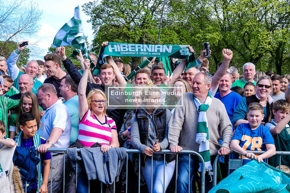 Edinburgh Sunday 22nd May 2015:  Hibernian Football Club fans celebrate their teams victory in the Scottish Cup at Leith Links.  The team paraded through the city of Edinburgh from the Lawnmarket to Leith Links where they were met by jubilant fans.<br /> <br /> (c) Andrew Wilson   Edinburgh Elite media