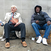 Took the short trip to DC last year to shoot the inauguration.  Walking through Judiciary Square, I stumbled on these two having a conversation.  They stuck out in a heavily congested area, where pro- and anti-Trump people were walking/protesting.  I approached both men and asked for a photo after introducing myself.  The man on the left, Pete, gave the ok as long as I took one of the flyers he was handing out to passerbys.  The gentlemen on the right was a local homeless man who was staying at a shelter nearby.  Unfortunately I did not write down his name, but he was real friendly.  Pete was proud to point out that he was talking with his new-found friend, who he didn't know until he had sat down with him.  Took a few shots with my DSLR, then my iPhone.  Of course, the iPhone turned out to be the best of the bunch.  Thanked them both, shook their hands, gave the homeless gentleman a few bucks for his time, then went on my way. Shortly after I took a look at the flyer Pete had handed me.  Unfortunately, it was a hodgepodge of erratically-placed, anti-Semitic headlines and stories about the end of the earth.  Pete Cojanis apparently is well known in the DC area as there has been a few things written about him.  WJLA did a segment on him and these flyers in 2011.
