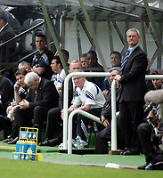 Photo. Andrew Unwin.<br /> Newcastle United v Chelsea, FA Barclaycard Premier League, St James Park, Newcastle upon Tyne 25/04/2004.<br /> Chelsea's manager, Claudio Ranieri, appears relaxed while it appears the stress is getting to Newcastle's Sir Bobby Robson.