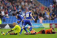 Cardiff City's Kenwyne Jones (9) turns away to celebrate after scoring his teams 1st goal leaving the Wolves players looking dejected on the floor. Skybet football league championship match, Cardiff city v Wolverhampton Wanderers at the Cardiff city stadium in Cardiff, South Wales on Saturday 22nd August 2015.<br /> pic by Carl Robertson, Andrew Orchard sports photography.