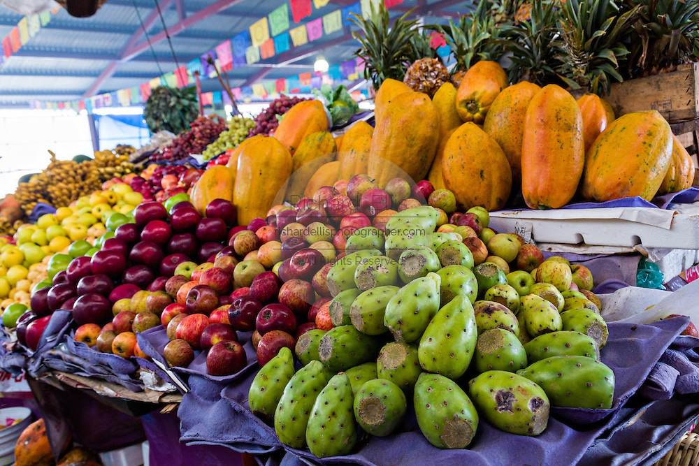 Fresh fruit stand at the Sunday market in Tlacolula de Matamoros, Mexico. The regional street market draws thousands of sellers and shoppers from throughout the Valles Centrales de Oaxaca.