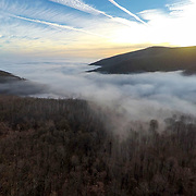 Clouds fill the valley of the Blue Ridge Mountains as the sun sets, pictured on Friday, Jan. 20, 2017 near Big Island, Va.
