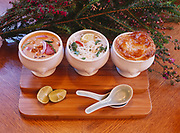 Homemade chicken broth used three ways - red curry chicken soup, Asian noodle soup, and chicken pot pie, prepared by Chef Kirsten Dixon of Winterlake Lodge, Alaska.