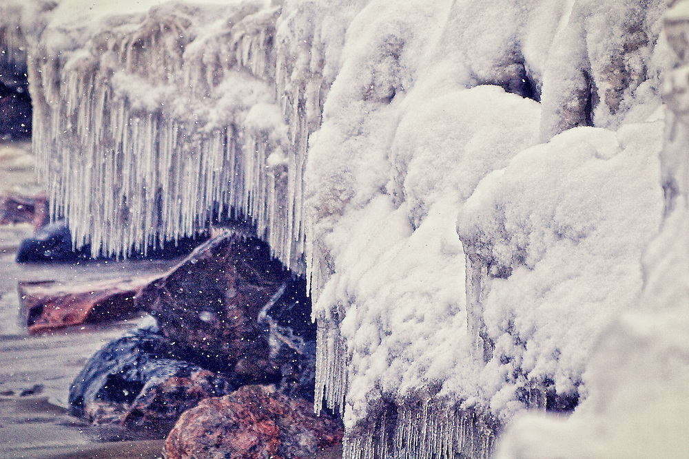A rockbed of ice and snow adorns Toronto's waterfront (Canada).