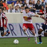 New York Red Bulls player Kenny Cooper is challenged by Oswaldo Minda, Chivas, USA, during the New York Red Bulls V Chivas USA Major League Soccer match at Red Bull Arena, Harrison, New Jersey, 23rd May 2012. Photo Tim Clayton