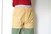 male person with shorts over pajama pants