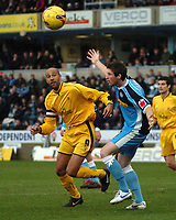 Photo: Tony Oudot.<br />Wycombe Wanderers v Notts County. Coca Cola League 2. 10/02/2007.<br />Mike Williamson of Wycombe with Jason Lee of Notts County