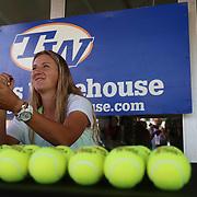 Victoria Azarenka signs autographs at the Indian Wells Tennis Garden in Indian Wells, California Tuesday, March 10, 2015.<br /> (Photo by Billie Weiss/BNP Paribas Open)