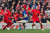 Everton's Phil Jagielka battles with Liverpool's Divock Origi (left) and Lucas Leiva (right)<br /> <br /> Photographer Terry Donnelly/CameraSport<br /> <br /> The Premier League - Liverpool v Everton - Saturday 1st April 2017 - Anfield - Liverpool<br /> <br /> World Copyright © 2017 CameraSport. All rights reserved. 43 Linden Ave. Countesthorpe. Leicester. England. LE8 5PG - Tel: +44 (0) 116 277 4147 - admin@camerasport.com - www.camerasport.com
