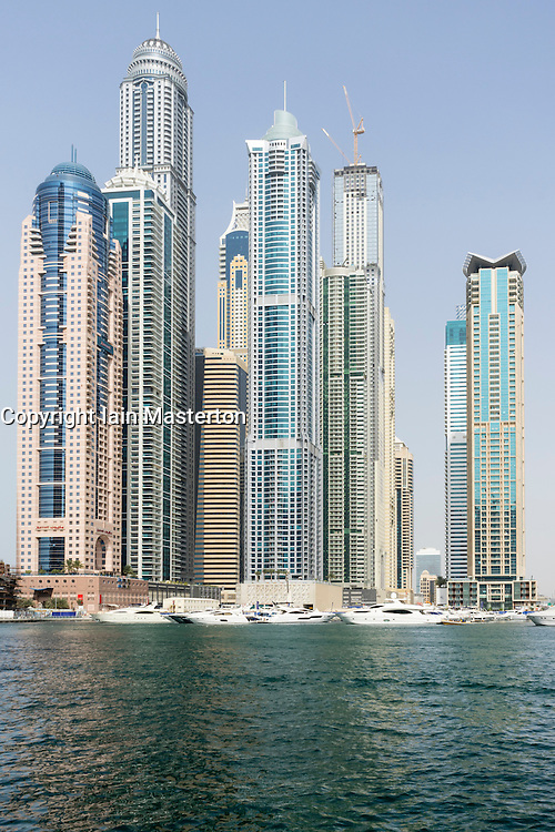 Very tall high-rise apartment towers in Marina district in new Dubai in United Arab Emirates