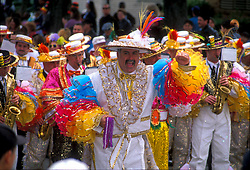 Group of men in costume in the mardi gras parade on the Strand in Galveston Texas