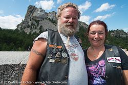 Richard Hicks and Karen Cafazzo of Batesville, IN at Mt Rushmore National Monument during the 75th Annual Sturgis Black Hills Motorcycle Rally.  SD, USA.  August 8, 2015.  Photography ©2015 Michael Lichter.