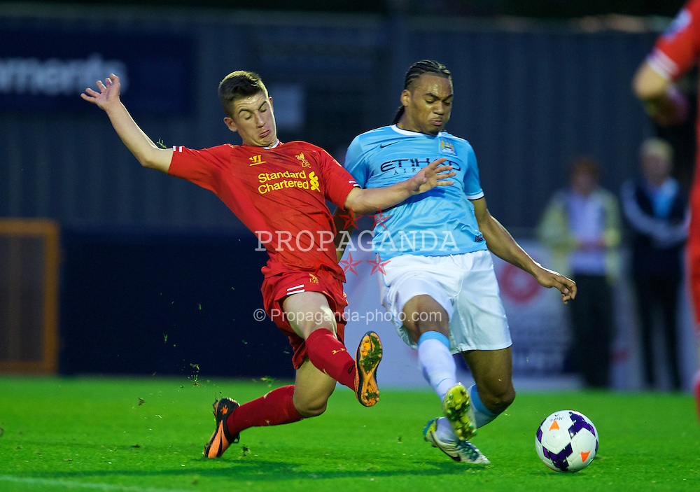 MANCHESTER, ENGLAND - Monday, September 23, 2013: Liverpool's Cameron Brannagan in action against Manchester City's Jason Denayer during the Under 21 FA Premier League match at Ewen Fields. (Pic by David Rawcliffe/Propaganda)