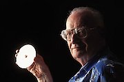 "Colombo, Sri Lanka.Sir Arthur C. Clarke holds a DVD copy of the movie 2001: A Space Odyssey. Clarke wrote, ""Any sufficiently advanced technology is indistinguishable from magic."" Referring to the DVD in his hand, he said, ""If I were able to give Thomas Edison this disc, he would have no idea of what it was or how it worked. It would be magic."" (He has post-polio syndrome) Best known for the book 2001: A Space Odyssey. MODEL RELEASED"