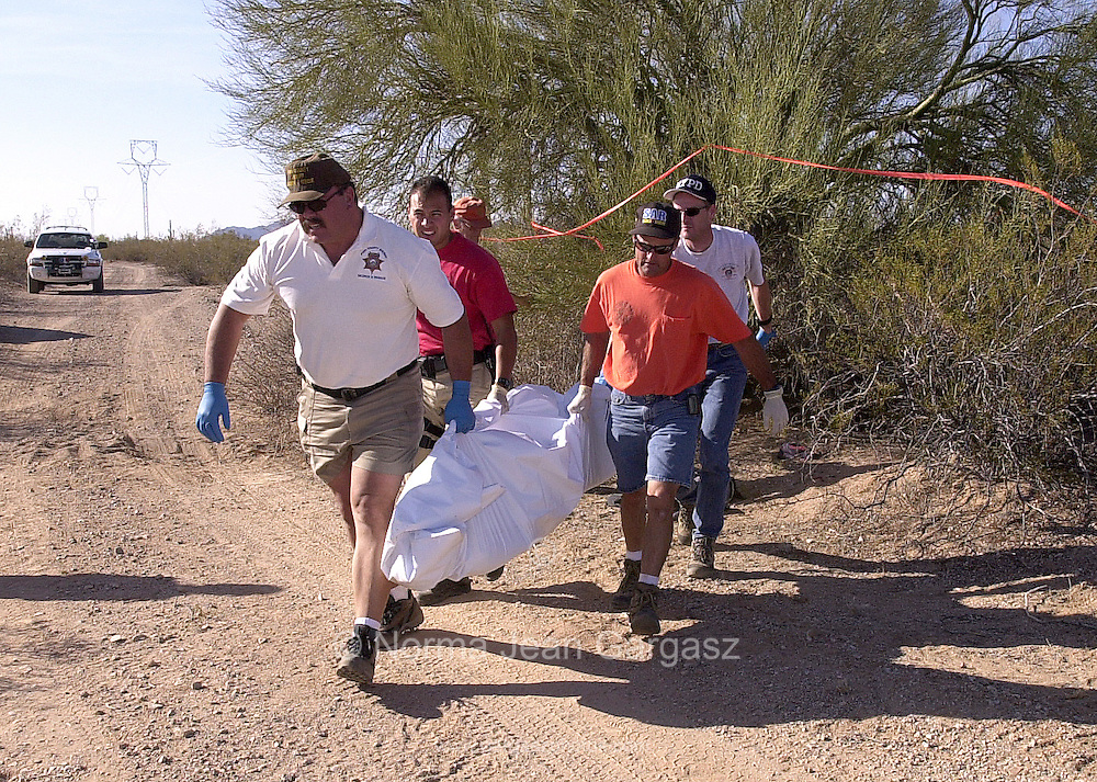 Authorities remove the body of Arturo Gomez Castro, 27, a father of five from Chiapas, Mexico, who entered the United States illegally at the Arizona border on to the Tohono O'odham Nation.  He died west of Silverbell in the Sonoran Desert.