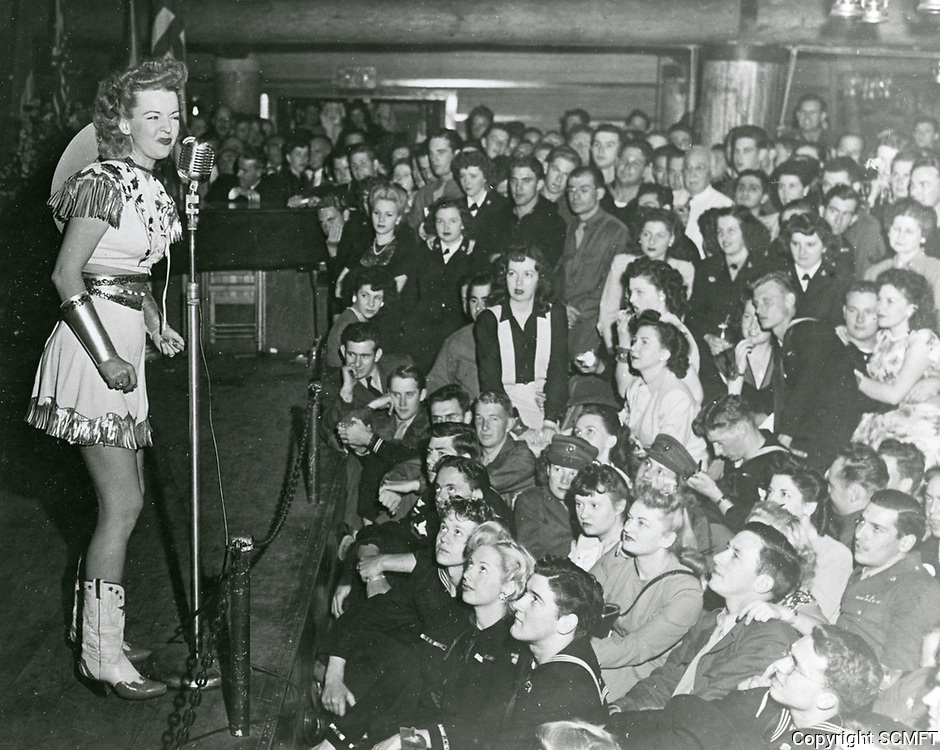1944 Dale Evans entertains the visiting servicemen at the Hollywood Canteen.