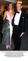 MISS NATHALIE BARIMAN and COUNT GOTTFRIED VON BISMARCK, at a gala evening on 10th June 2004.PWB 18