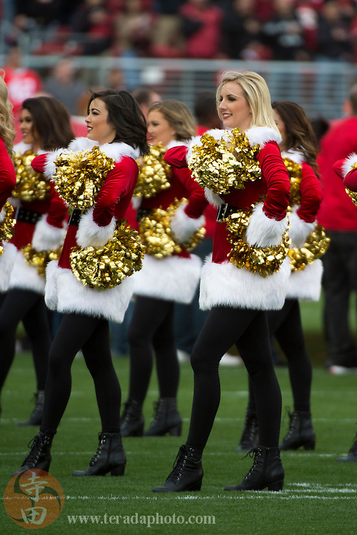 December 20, 2015; Santa Clara, CA, USA; San Francisco 49ers Gold Rush cheerleaders Aleena (left) and Brooklyn (right) perform in Santa outfits before the game against the Cincinnati Bengals at Levi's Stadium. The 49ers defeated the Bengals 24-14.